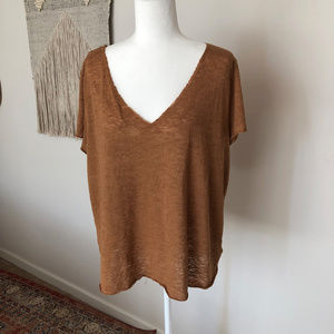 Oversized tan tee with raw edges